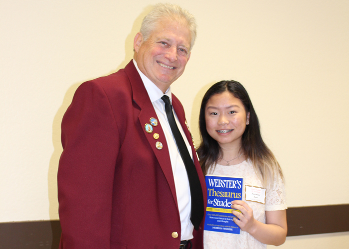Left to right are Gary Grayson, Exalted ruler - Elks Lodge #6, Jazmin Lor, Capital City High School